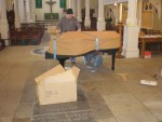 Starting to unwrap the piano